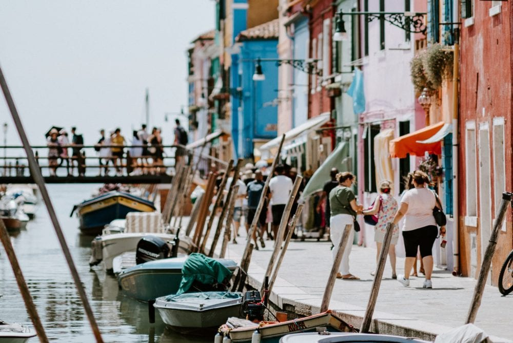 tourists crowding venice italy burano island residential area